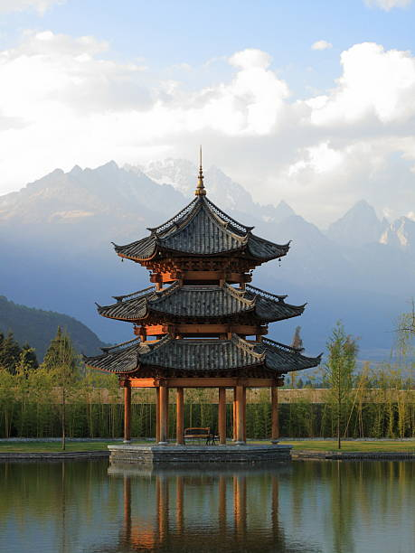 Chinese Pagoda Pavilion with Mountains in Background  pagoda stock pictures, royalty-free photos & images