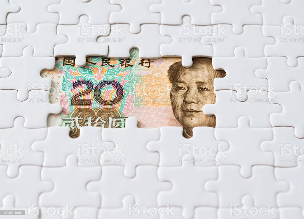 Chinese paper currency with jigsaw puzzle stock photo