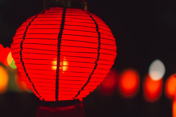 chinese paper lamp red color hanging at night - kratong stock photos and pictures