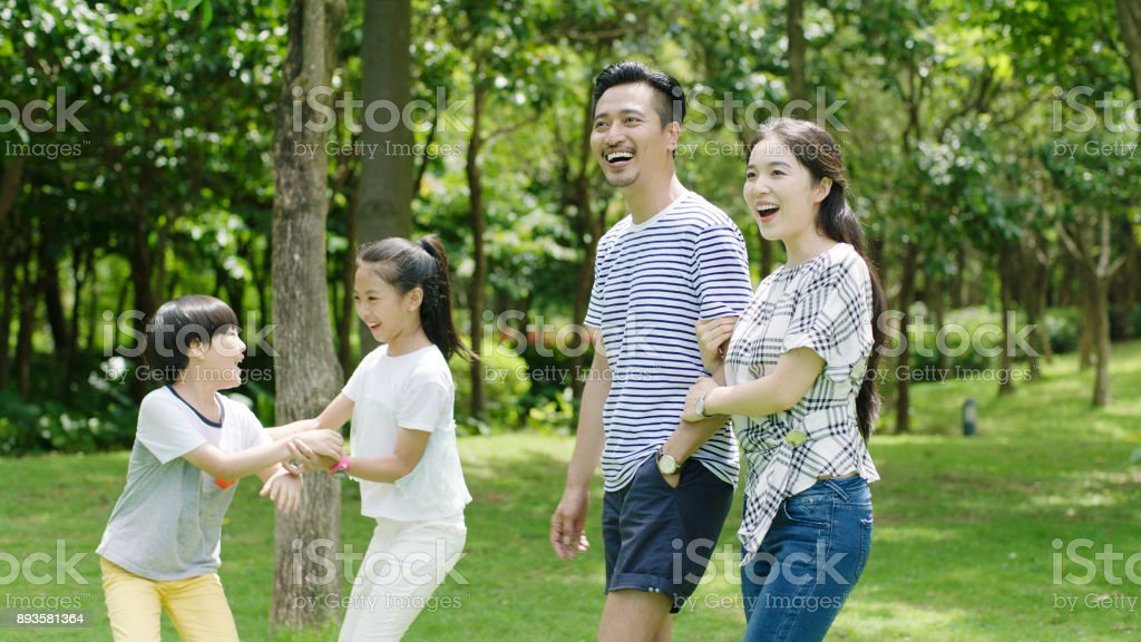 Chinese parents and kids enjoying family time in park in summer stock photo