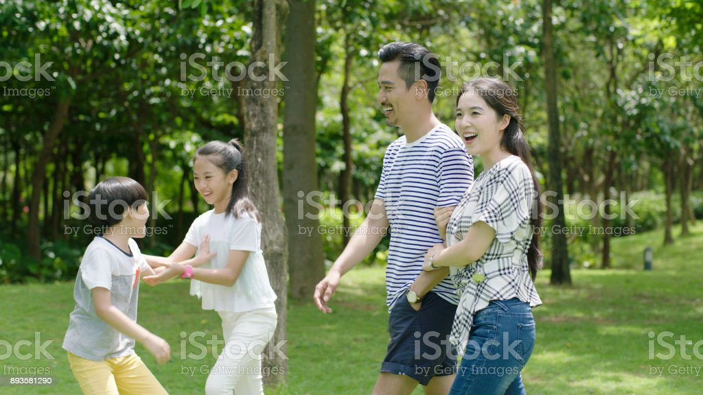 Chinese parents & kids enjoying weekend activity in park in summer stock photo