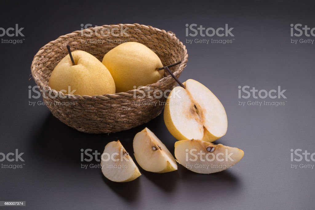 Chinese pear fruits on black background foto de stock royalty-free