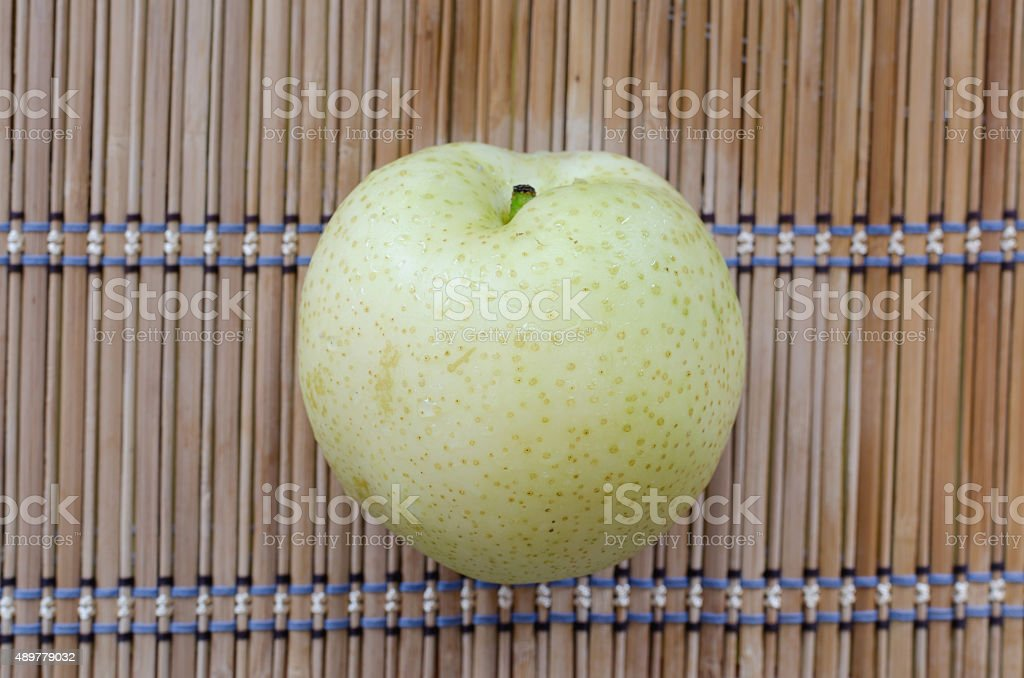 chinese pear on mat stock photo