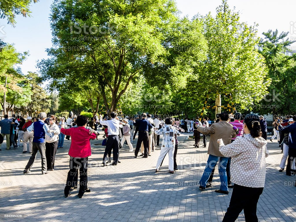 Chinese people dancing in a park stock photo