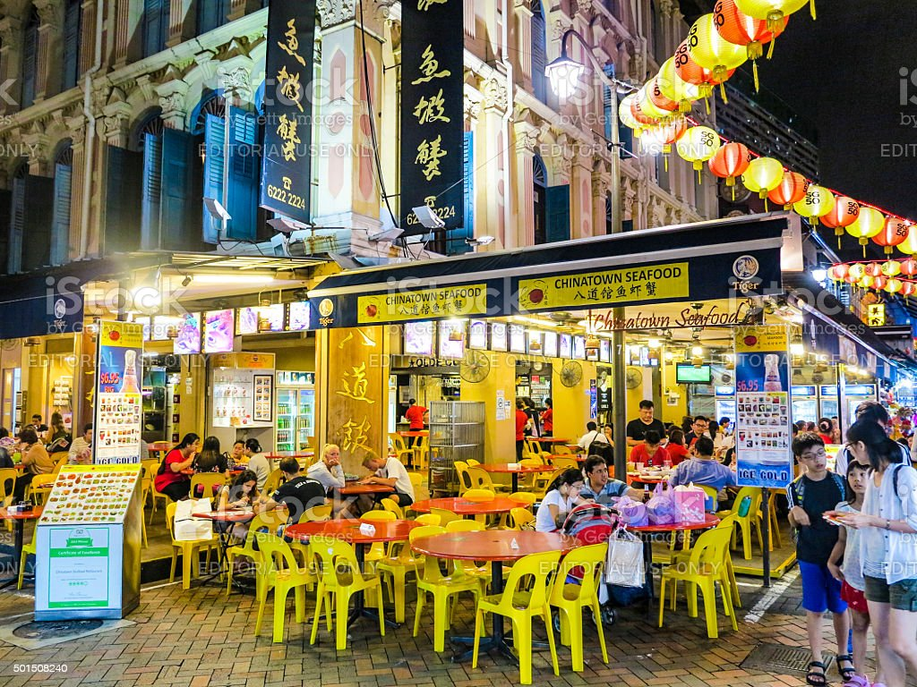 chinese people go eating in the evening in chinatown stock photo