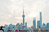 Shanghai, Сhina - September 25, 2015: Chinese people in Shanghai Bund to play tai chi