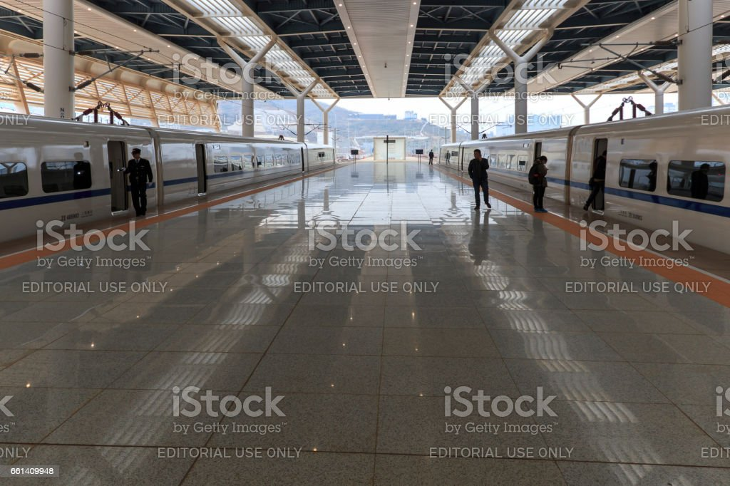 Chinese people inside the newly opened high speed train station in Kunming. The new fast train station links Kunming to Beijing, Shanghai and Guangzhou stock photo