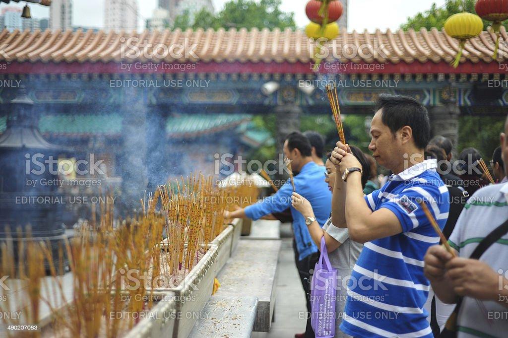 Chinese people praying at Wong Tai Sin temple stock photo