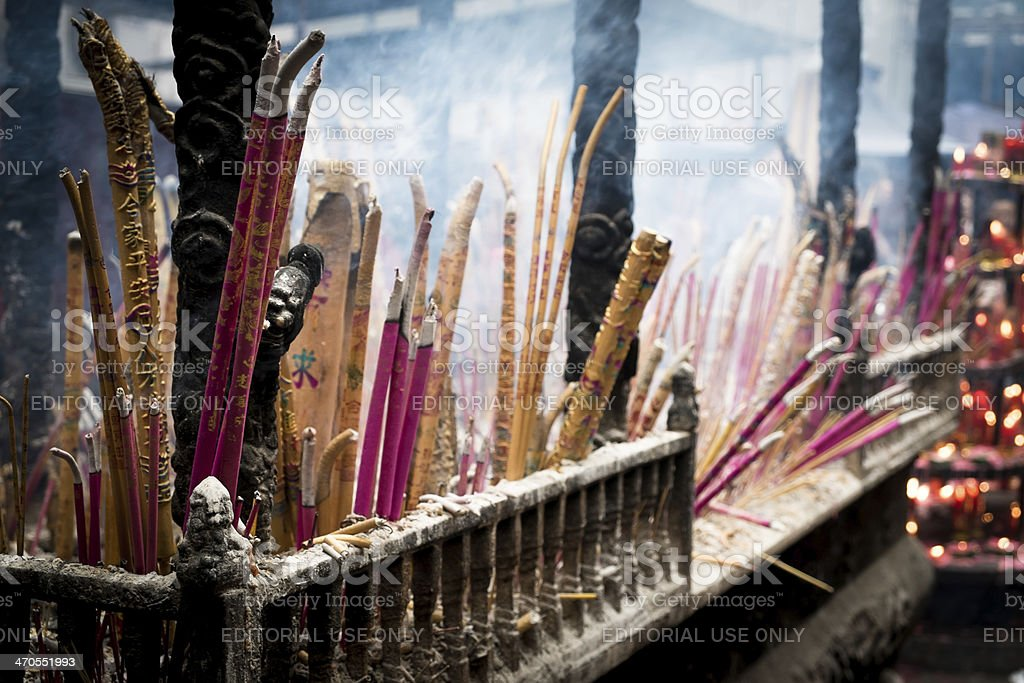 Chinese people worship with incenses, candles and oil lamps royalty-free stock photo