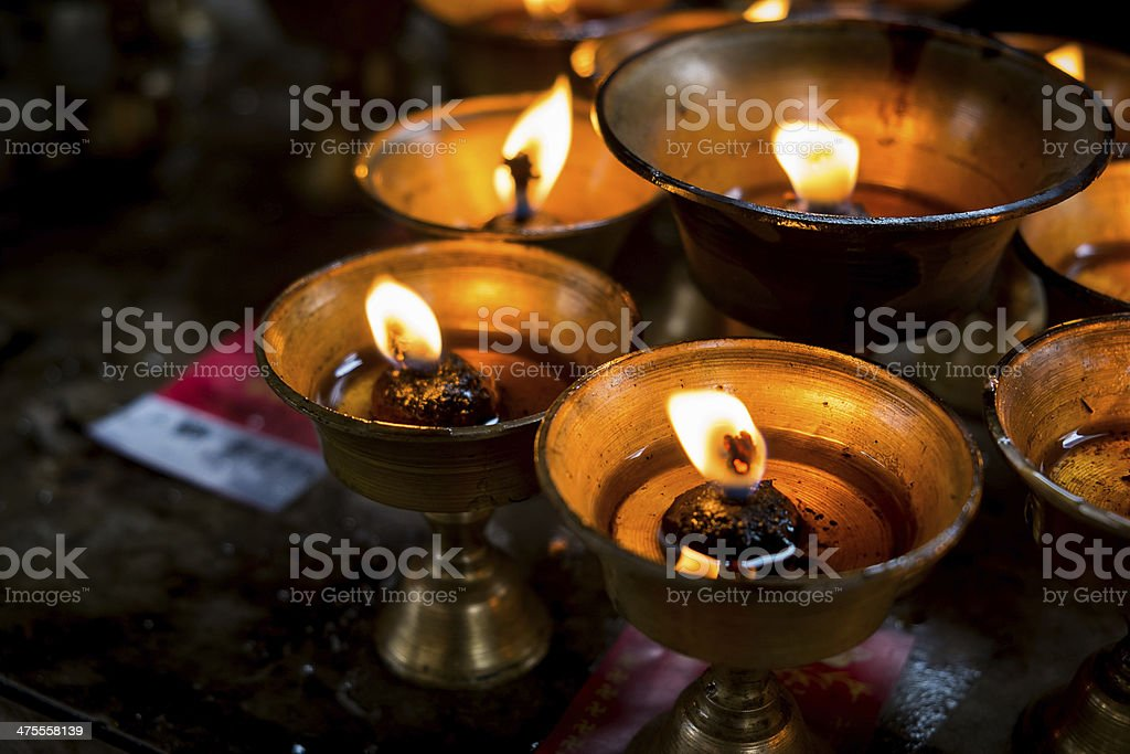 Chinese people worship with oil lamps stock photo