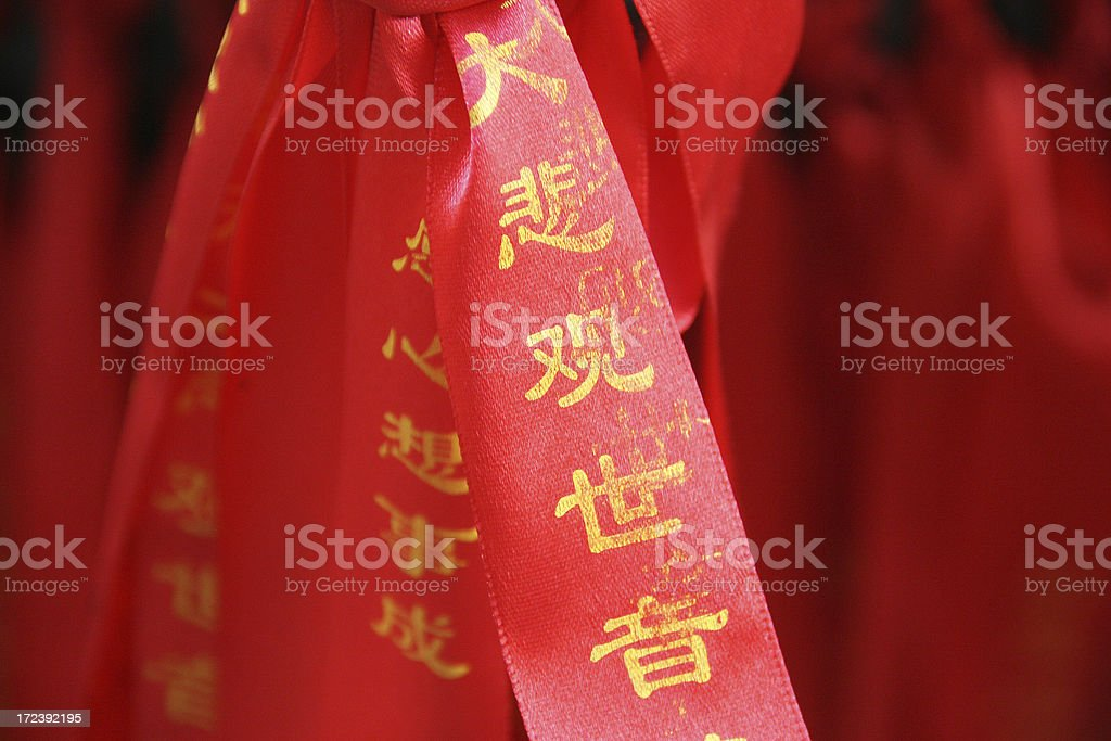 Chinese prayer in a temple royalty-free stock photo