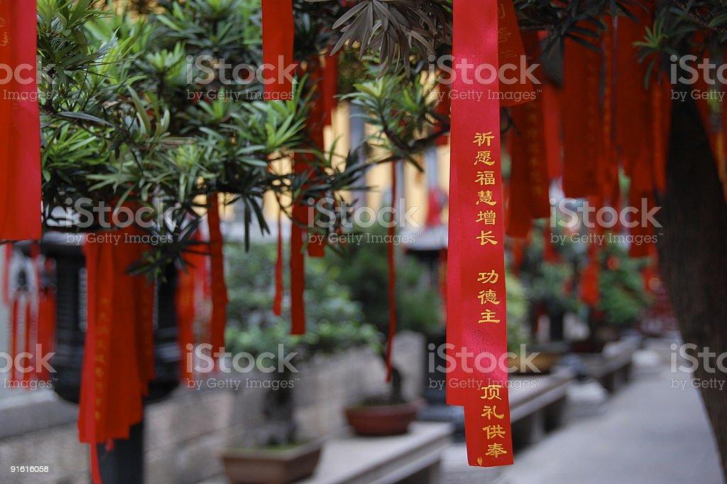 Chinese prayer ribbons hanging from bonsai trees - Royalty-free Bonsai Tree Stock Photo