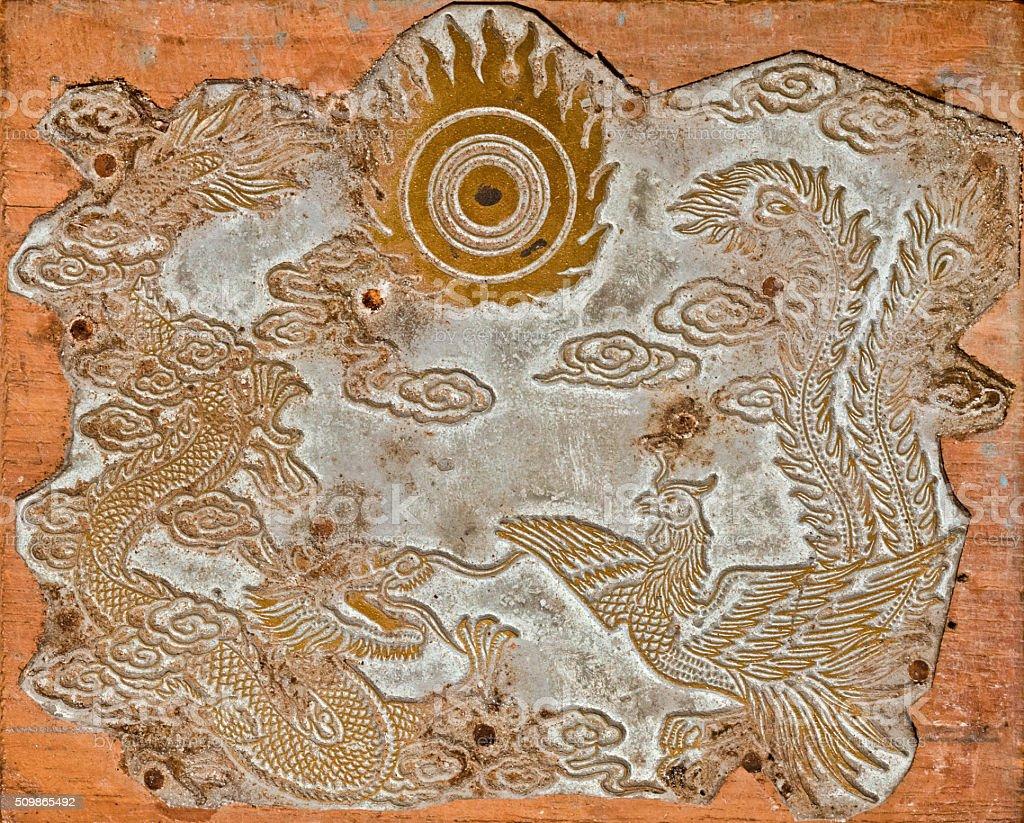 Dragón chino molde de impresión y Phoenix - foto de stock