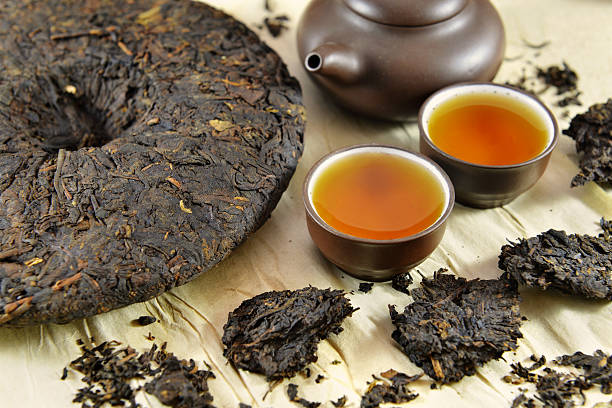 Chinese Pu-Erh tea with two cups and pot stock photo