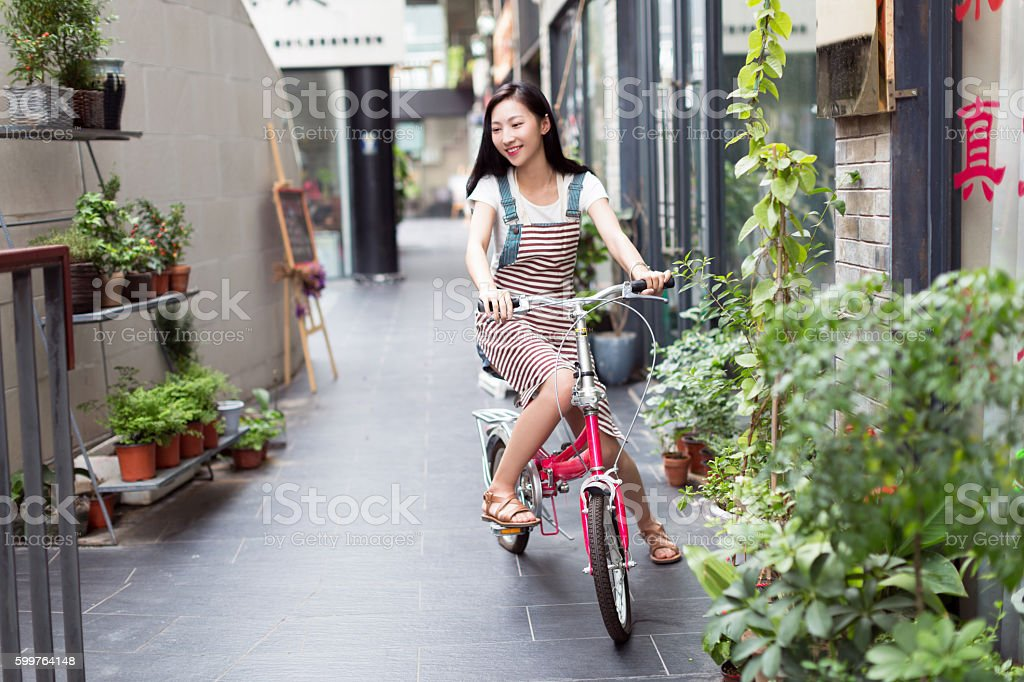 chinese rapunzel riding a bicycle stock photo