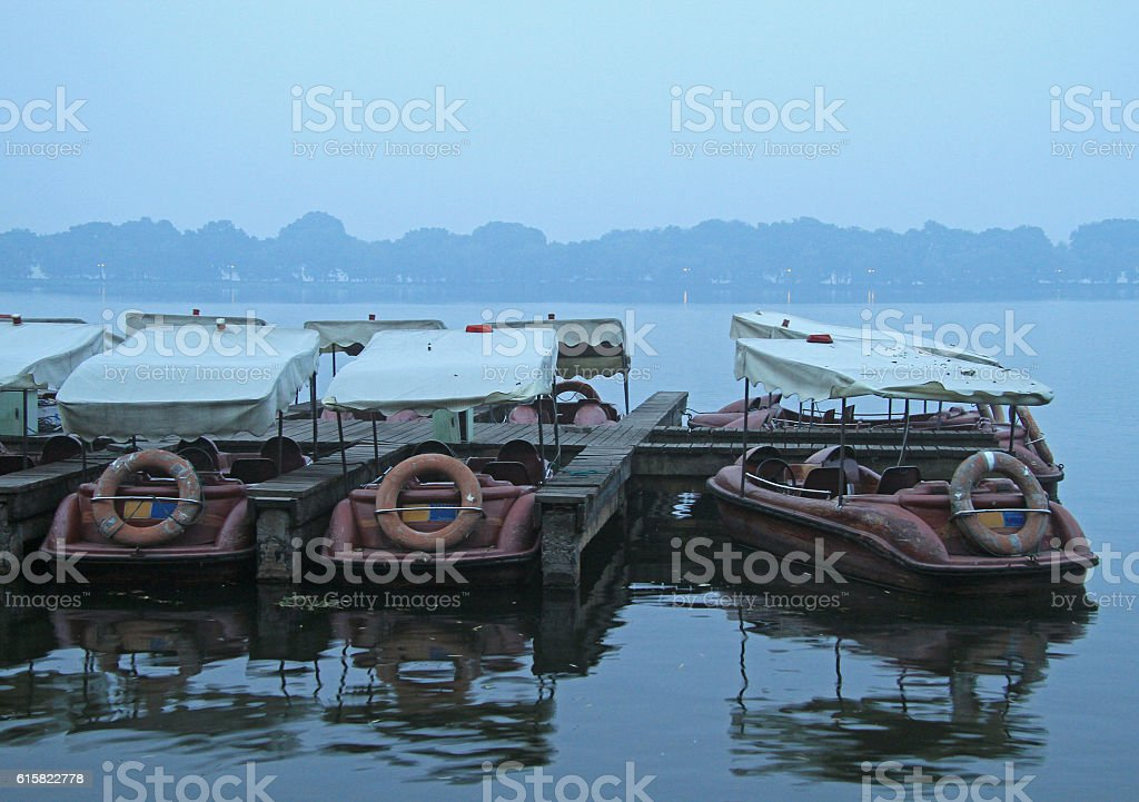 Chinese recreation boats are moored on the West Lake coast stock photo