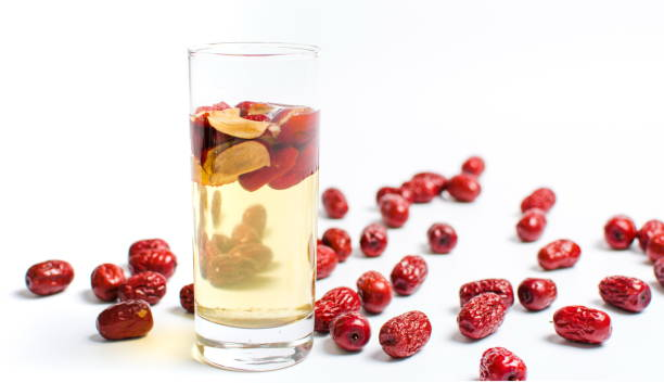 Chinese red dates fruit tea in a glass Chinese red dates fruit tea in a glass on white jujube candy stock pictures, royalty-free photos & images