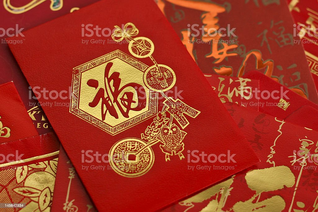 Chinese Red Pockets with gold auspicious prints royalty-free stock photo