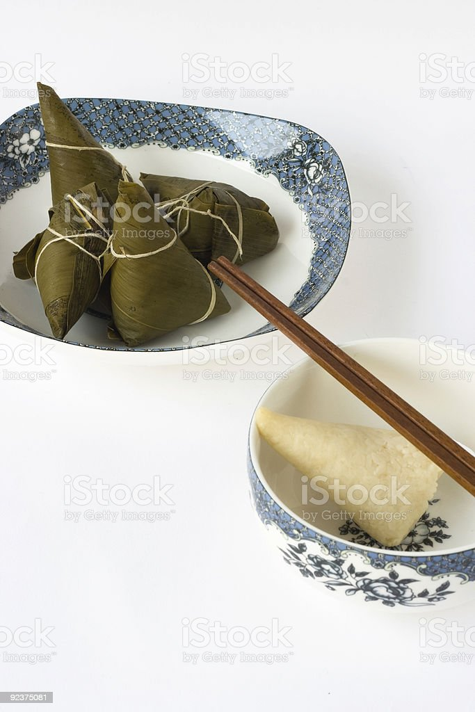 Chinese rice dumplings with porcelain royalty-free stock photo