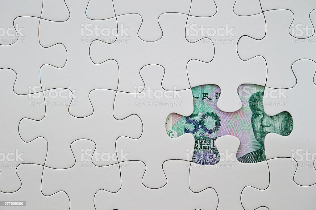 Chinese RMB bill with jigsaw puzzle stock photo