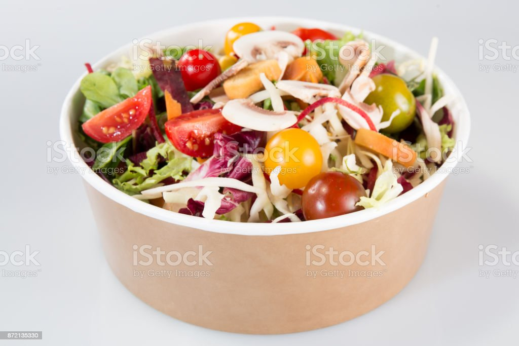 chinese Salad in carton takeaway container on white background stock photo