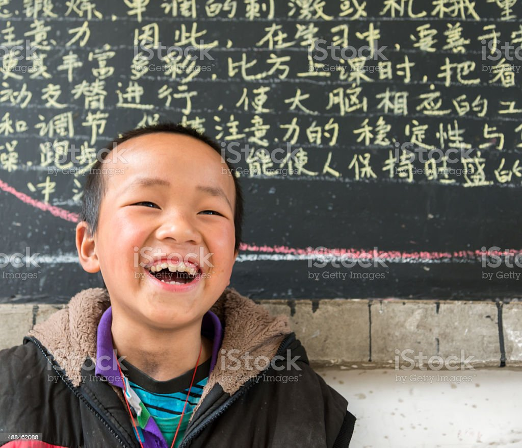 Chinese School boy, looking at camera, cheerful stock photo