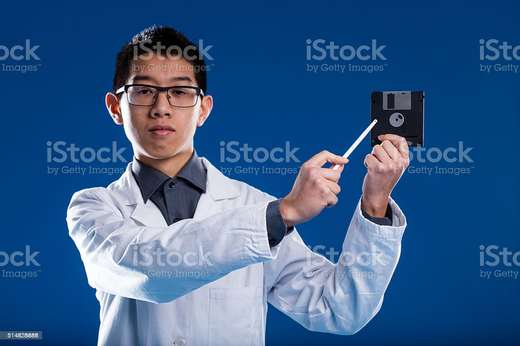 chinese scientist demonstrating ancient technology stock photo