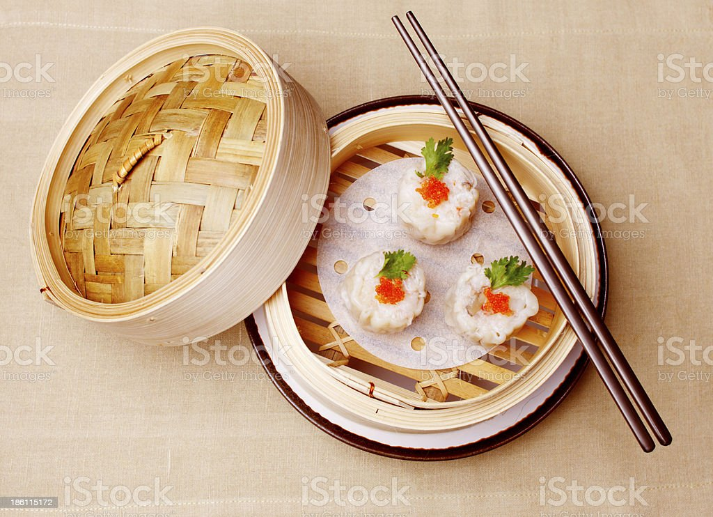 Chinese seafood dumplings garnished with red caviar and parsley stock photo