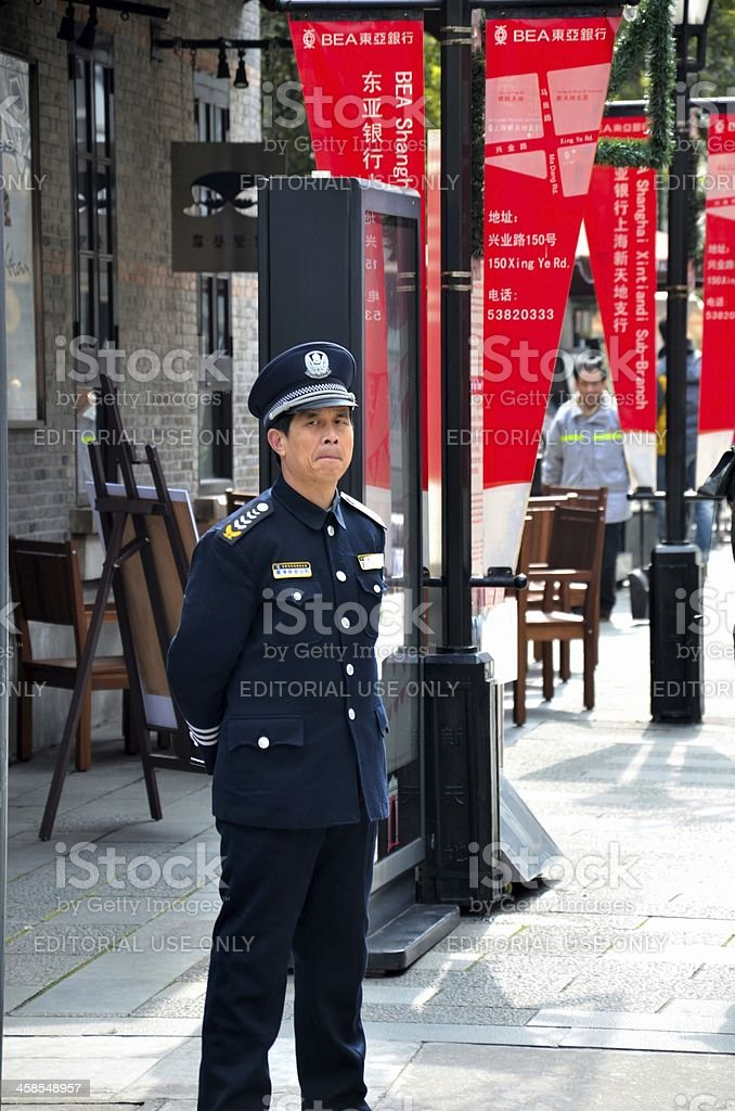 Chinese security guard stands alert Shanghai, China royalty-free stock photo