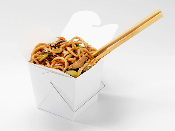 Chinese Shanghai Noodles with Chopsticks Chinese Shanghai Noodles with Chopsticks in Take Out Container -Photographed on Hasselblad H1-22mb Camera chinese takeout stock pictures, royalty-free photos & images