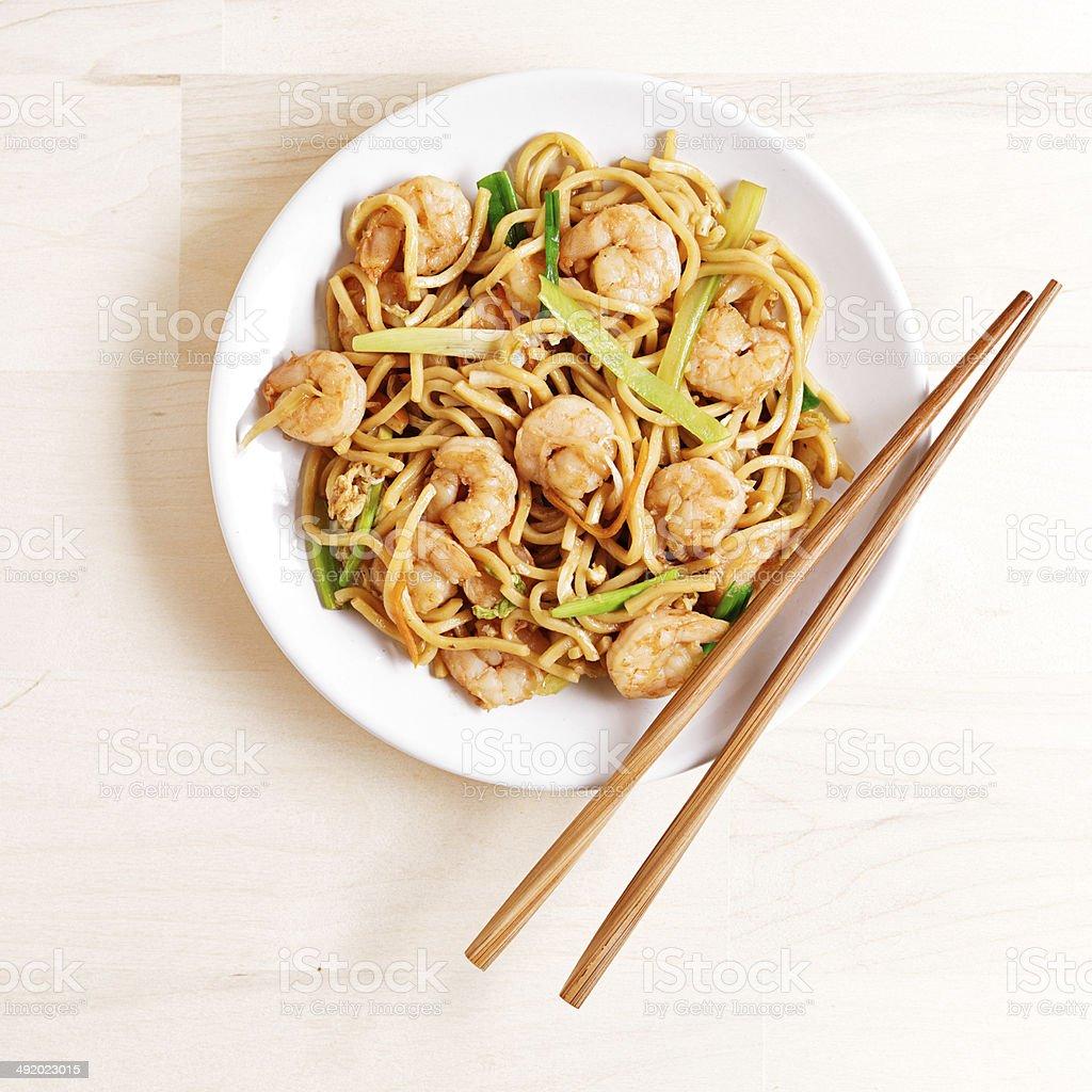 chinese shrimp lo mein overhead shot stock photo