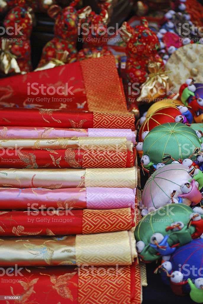 Chinese silk and tourist items in Asian market royalty-free stock photo