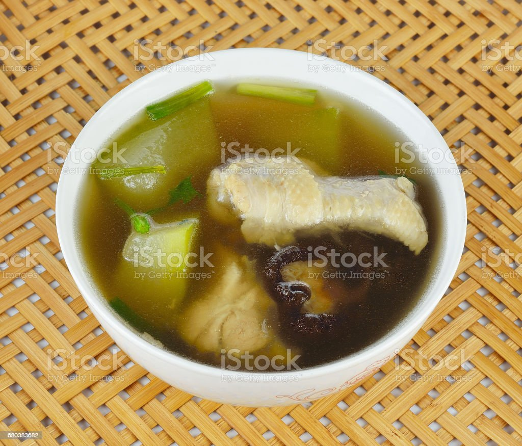 Chinese soup chicken with gourd vegetable and mushroom closeup royalty-free stock photo