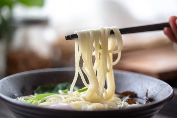 Chinese soup noodle with boiled egg and vegetable stock photo