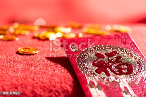 istock Chinese Spring Festival Fortune Character red envelope and Gold Coins 1091165802