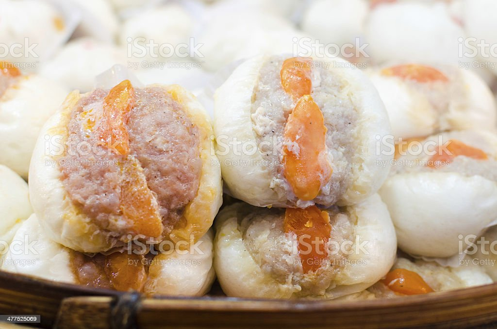Chinese steamed bun stuffed with  pork and yolk. royalty-free stock photo