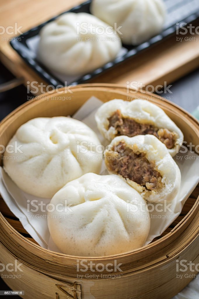 chinese steamed buns on wood container , selective focus stock photo
