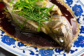 A dish of steamed fish cooked in Chinese style.