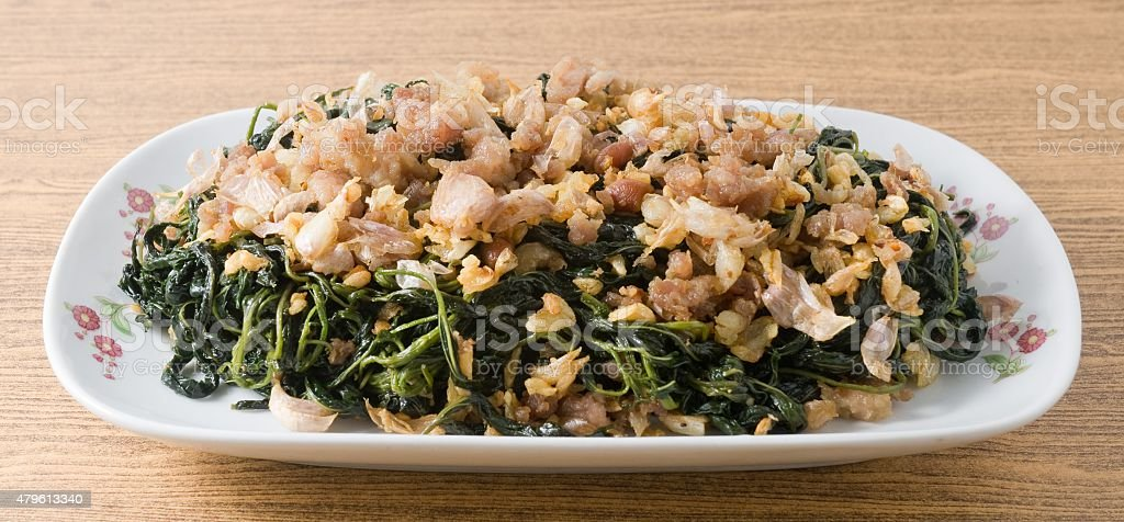 Chinese Stir Fried Jute Leaves with Minced Pork stock photo