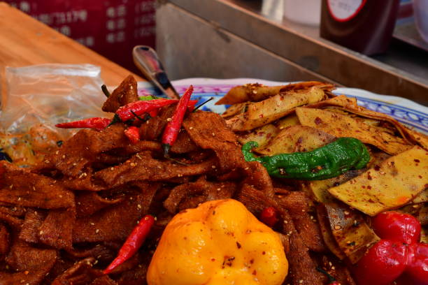 Chinese street food in the Muslim Quarter of Xian Chinese street food in the Muslim Quarter of Xian muslim quarter stock pictures, royalty-free photos & images