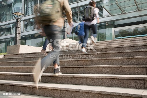 istock Chinese students running on campus 1083161184