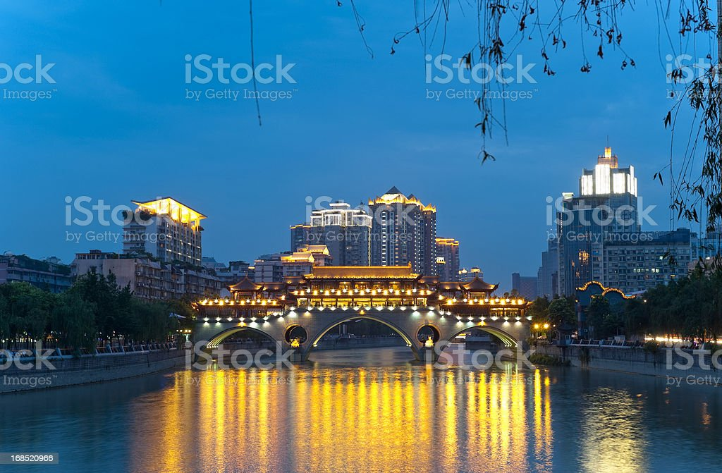 Chinese style bridge in front of skyscrapers stock photo