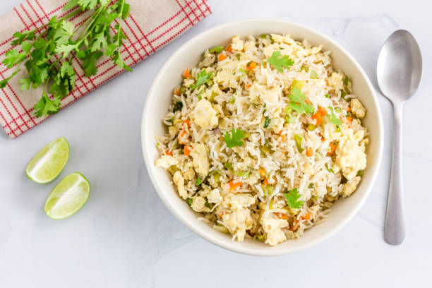 Chinese Style Egg Fried Rice Chinese Style Egg Fried Rice with Vegetables and Cilantro High Angle View / Directly Above Photo. Fried Rice, Comfort Food, Oriental Cuisine Concept. fried rice stock pictures, royalty-free photos & images
