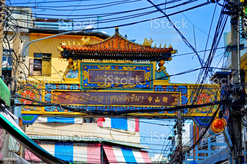 Chinese style gate among a lot of wires in Chinatown, Bangkok stock photo