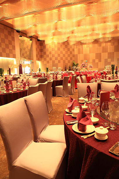 Chinese style wedding reception hall Chinese style Wedding reception hall and tables setting, Restourant ready for a wedding dinner party indoor. chinese wedding dinner stock pictures, royalty-free photos & images