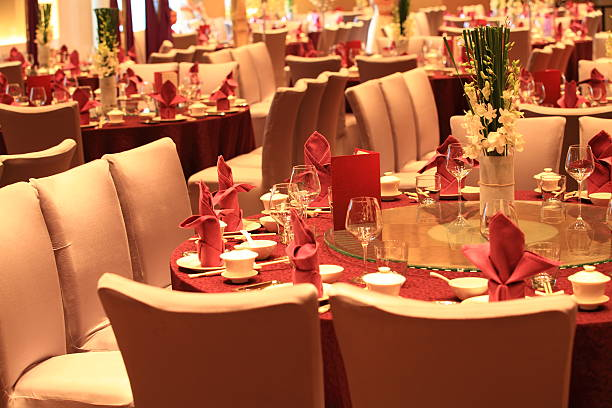Chinese style Wedding reception tables Chinese style Wedding reception tables setting, Restourant ready for a wedding dinner party indoor. chinese wedding dinner stock pictures, royalty-free photos & images