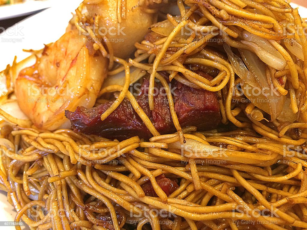 Chinese Take away - Egg noodles with mixed meat stock photo
