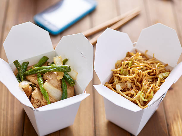 chinese take out food in boxes close chinese take out food in boxes close up with mobile phone in background chinese takeout stock pictures, royalty-free photos & images
