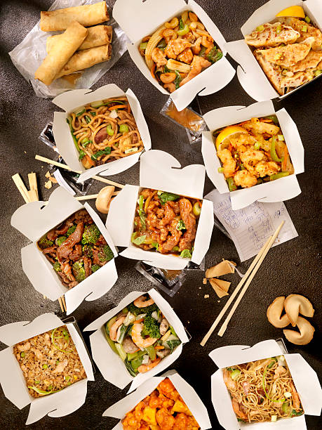 Chinese Take Out A huge Meal of All Your Favourite Chinese Foods -Photographed on Hasselblad H3D2-39mb  chinese takeout stock pictures, royalty-free photos & images