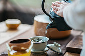 Woman serving Chinese tea in a tea ceremony.